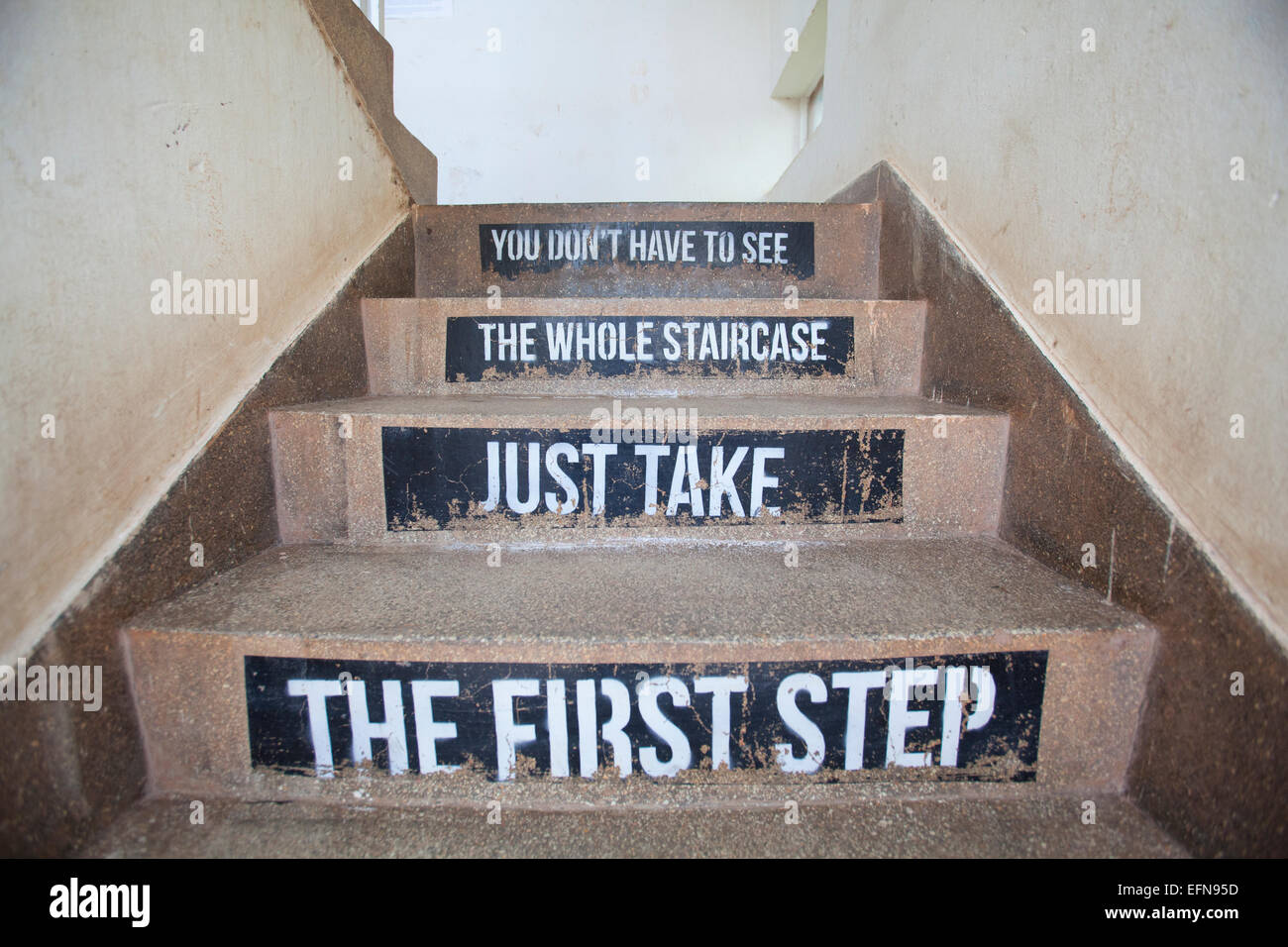 Staircase with motivational message, 'You don't have to see the whole staircase, just take the first step'. - Stock Image
