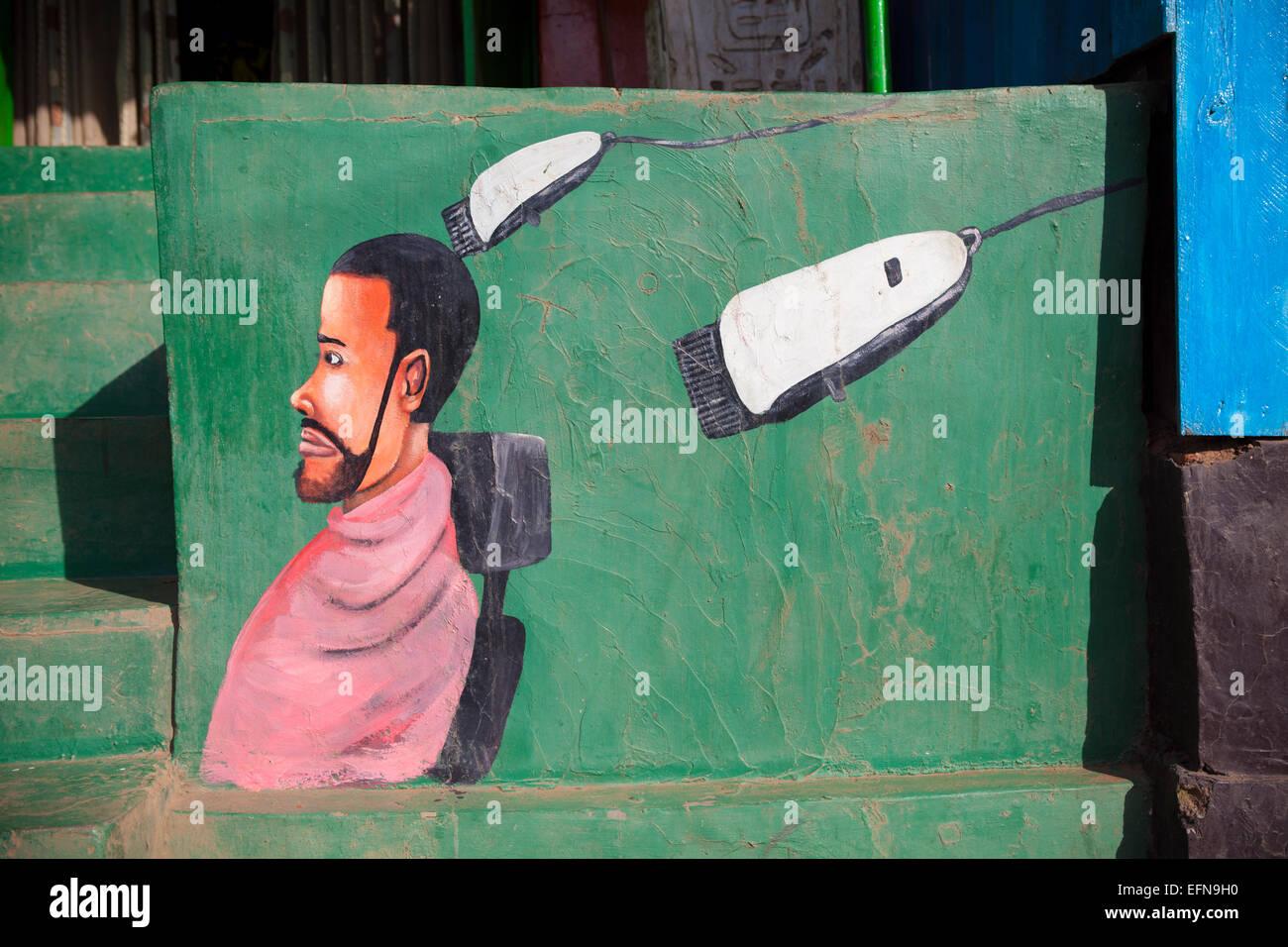 Mural outside barber shop, Kigali, Rwanda - Stock Image