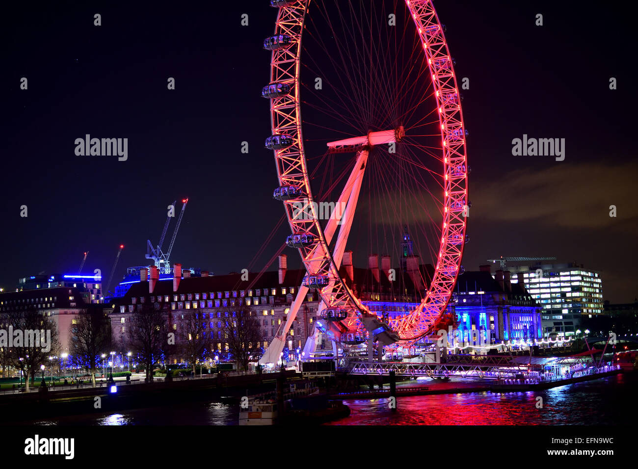 The London eye on Southbank at night - Stock Image