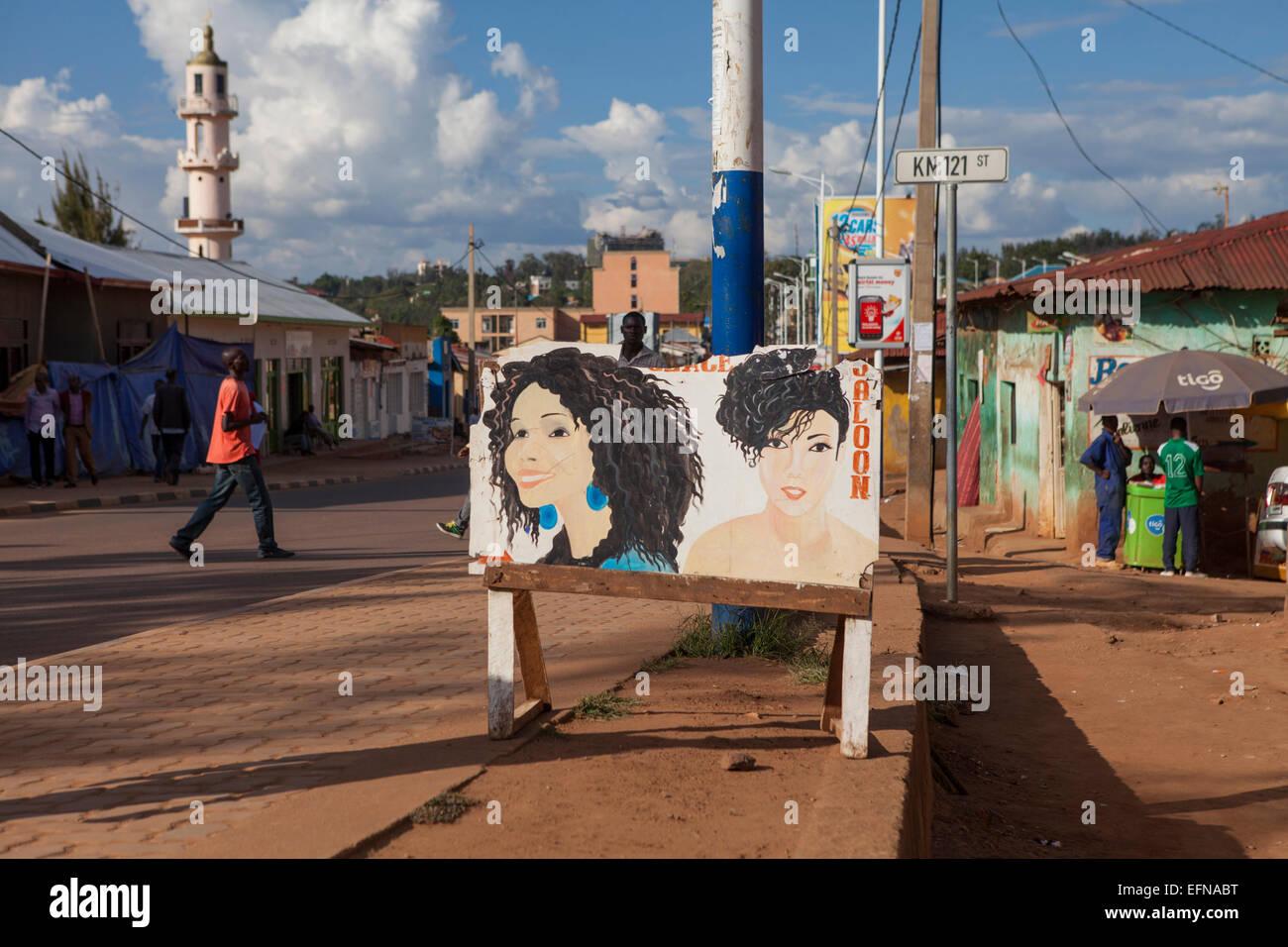 Painted sign for a hair salon in Nyamirambo the Muslim quarter of Kigali, Rwanda - Stock Image