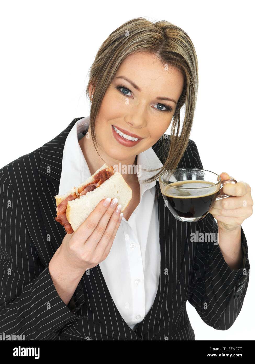 young-happy-business-woman-eating-a-baco