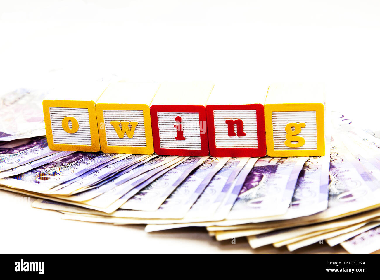 Owing money lender debt debts loan loans pounds cash shark payment pay cut out copy space white background - Stock Image