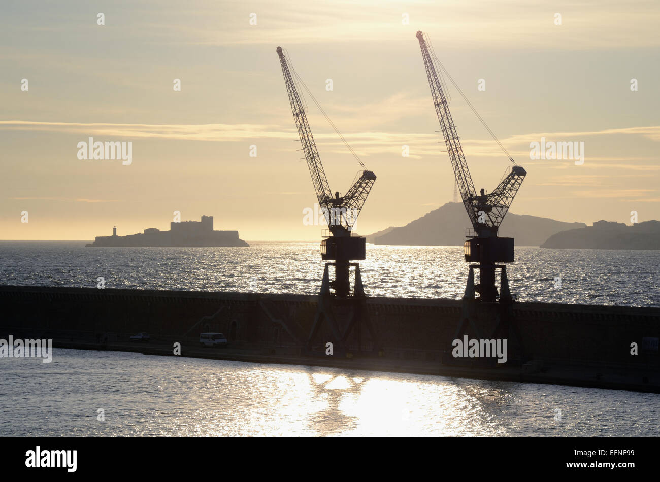 Outlines or Silhouette of Château d'If, Frioul Islands & Cranes of Marseille Port or Docks Marseille - Stock Image