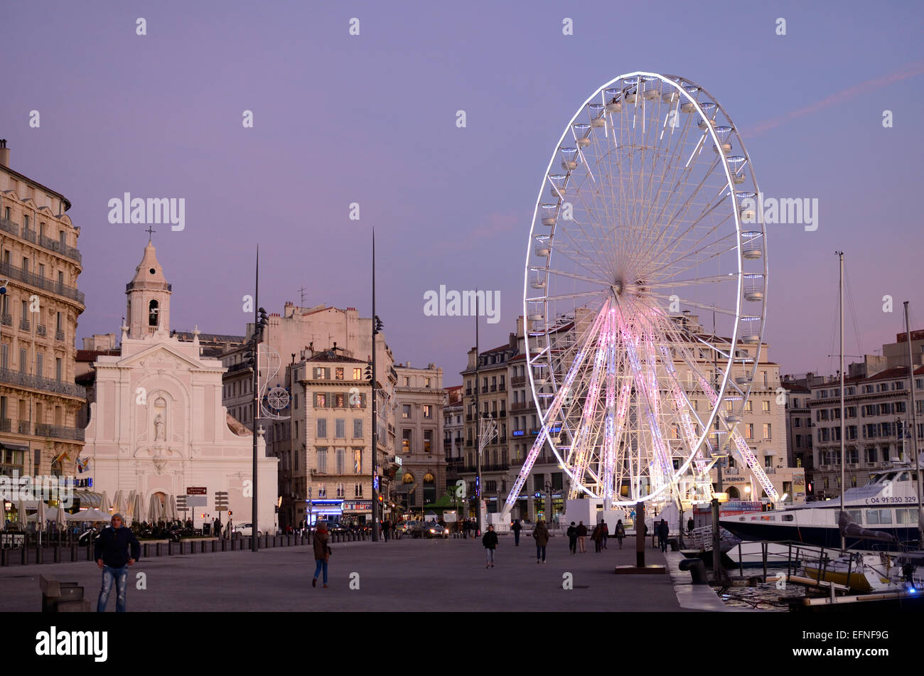 Old Port or Vieux Port with Quayside, Saint-Ferréol les Augustins Church and Ferris Wheel or Big Wheel at Night - Stock Image