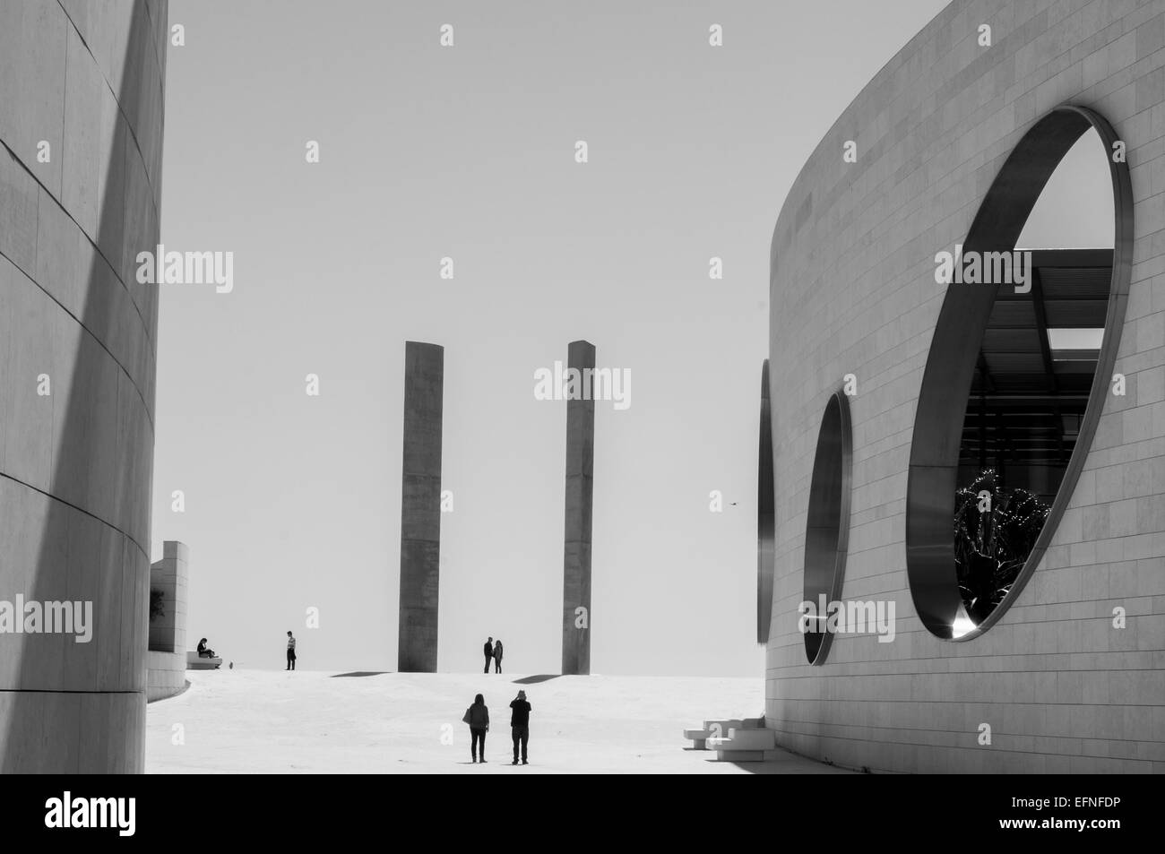 Black and white photo of people walking by the areas around Champalimaud Foundation in Lisbon. - Stock Image