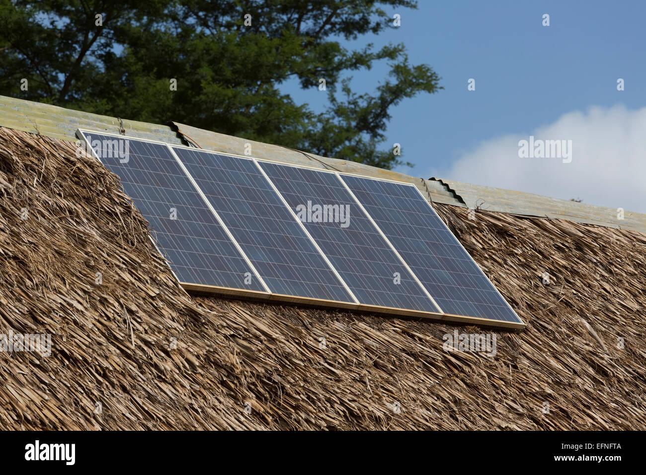 Solar PV panels on roof of park entrance Tsavo Kenya - Stock Image