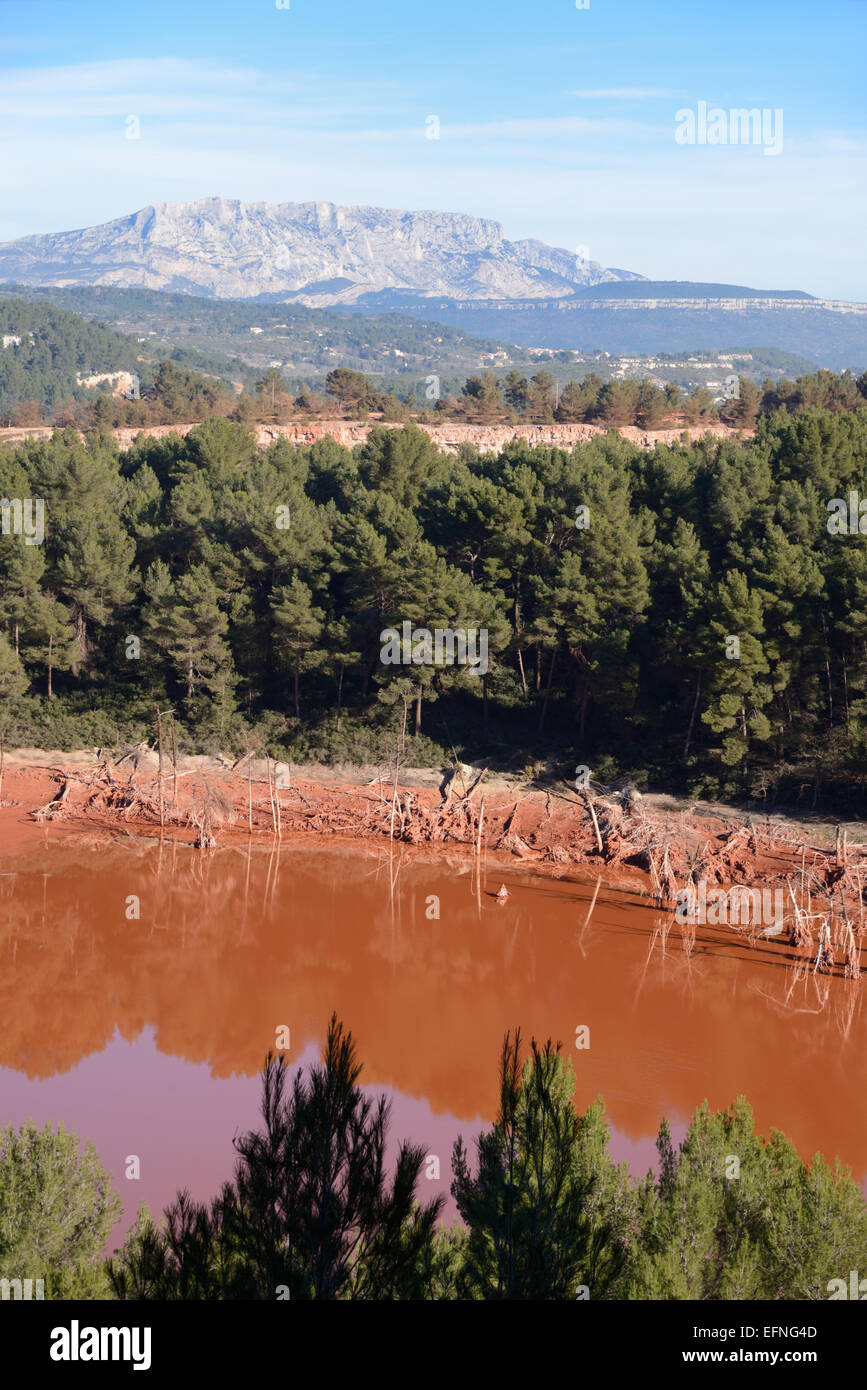 Bauxite Residue Storage Area from Aluminium or Aluminum Factory Altéo at Gardanne with  Sainte-Victoire Mountain - Stock Image