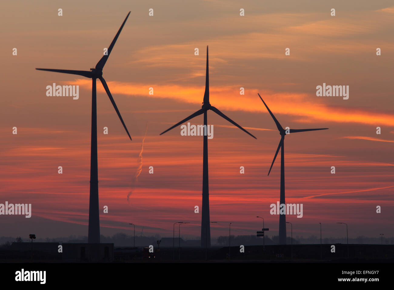 Sunset over the wind turbines in Eemshaven, The Netherlands - Stock Image