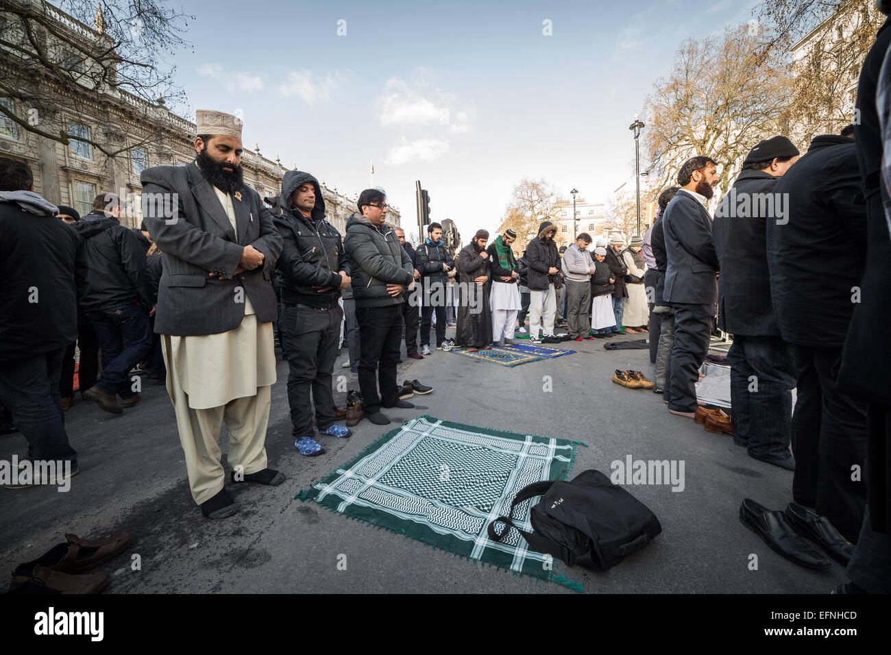 London, UK. 8th Feb, 2015. British Muslims noon-prayers on Whitehall. Credit:  Guy Corbishley/Alamy Live News - Stock Image