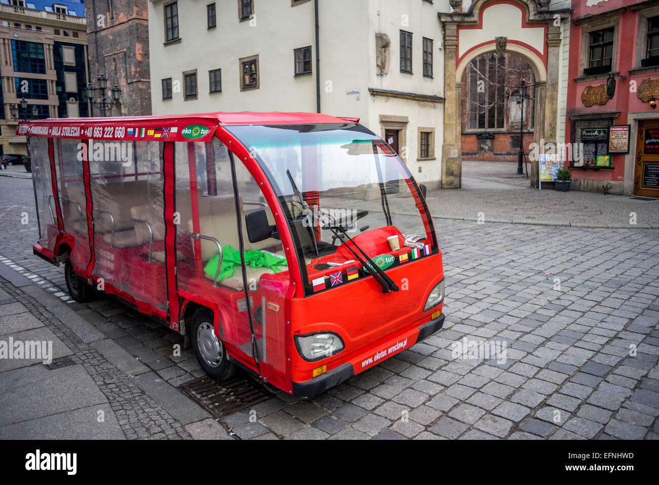 Tourist vehicle for exploring the city Wroclaw Old Market - Stock Image