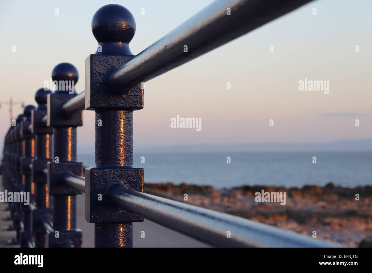 Blue cast iron railings on seaside promenade - Stock Image