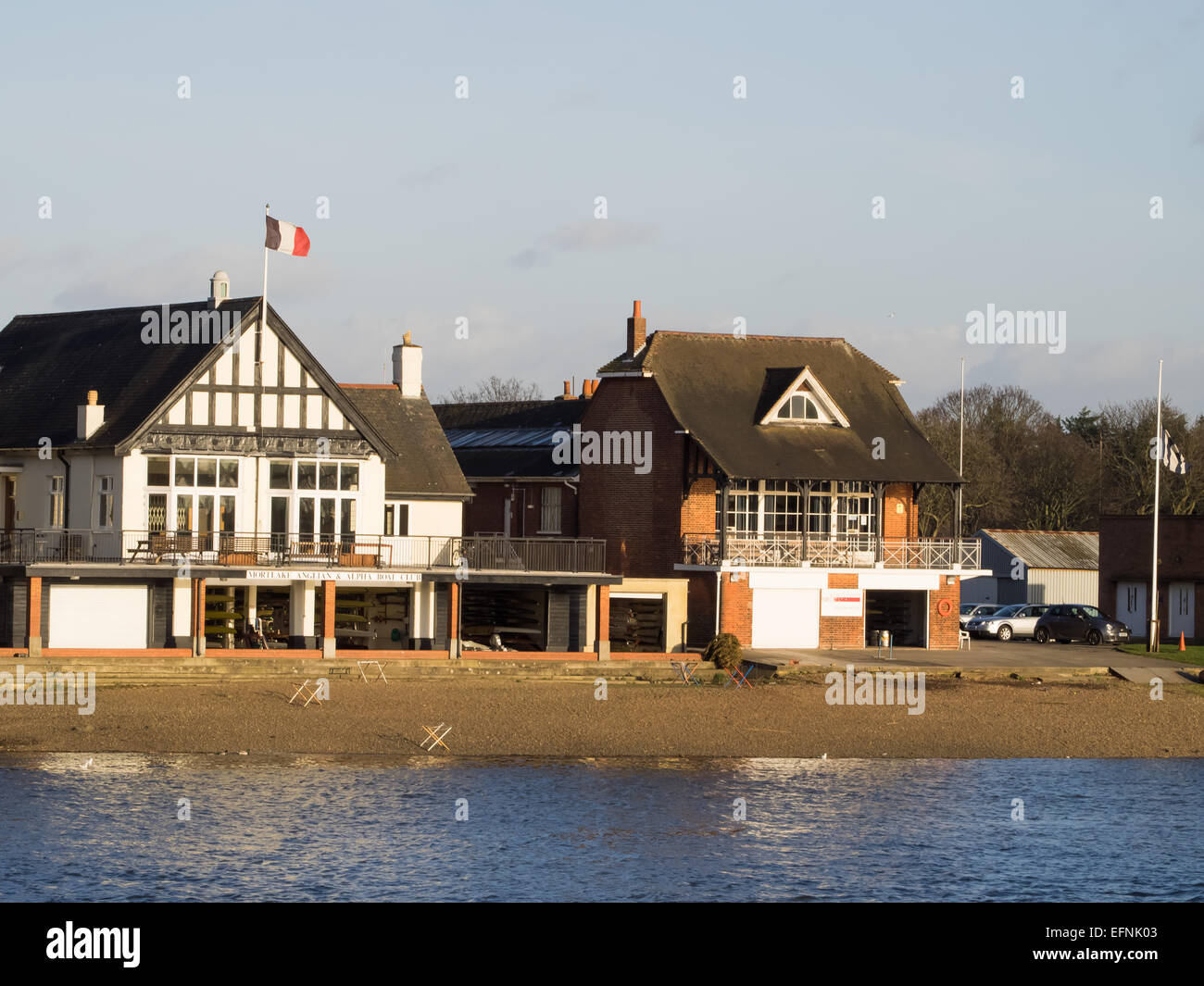 Boathouses at finish of Oxford and Cambridge University Boat race, Chiswick, River Thames - Stock Image