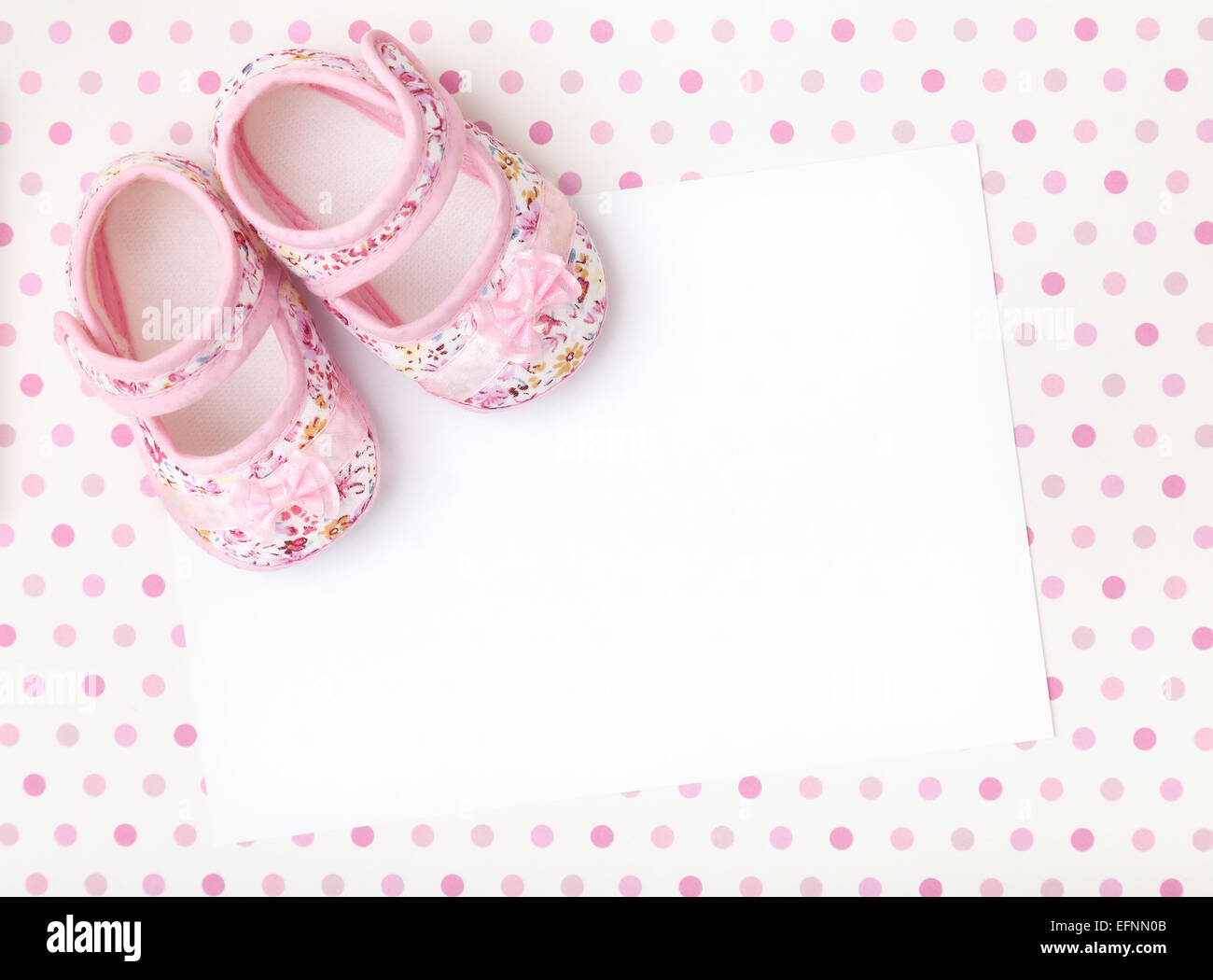 b45bc40c10a Blank card with baby girl shoes on a pastel pink spotted background ...