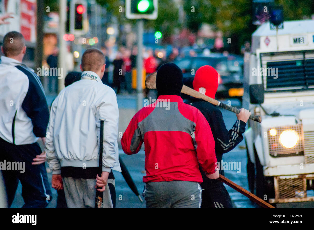 Belfast, Northern Ireland. 31 Aug 2009 - Rival groups of Nationalist (foreground) and Loyalist (background) youths - Stock Image