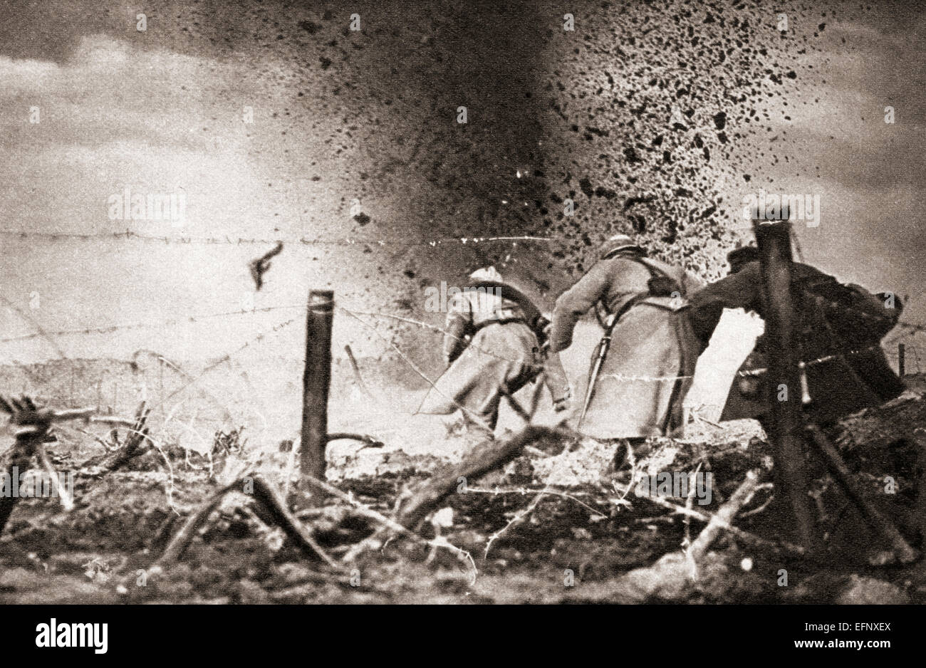 A high explosive shell exploding over French troops during World War One. - Stock Image