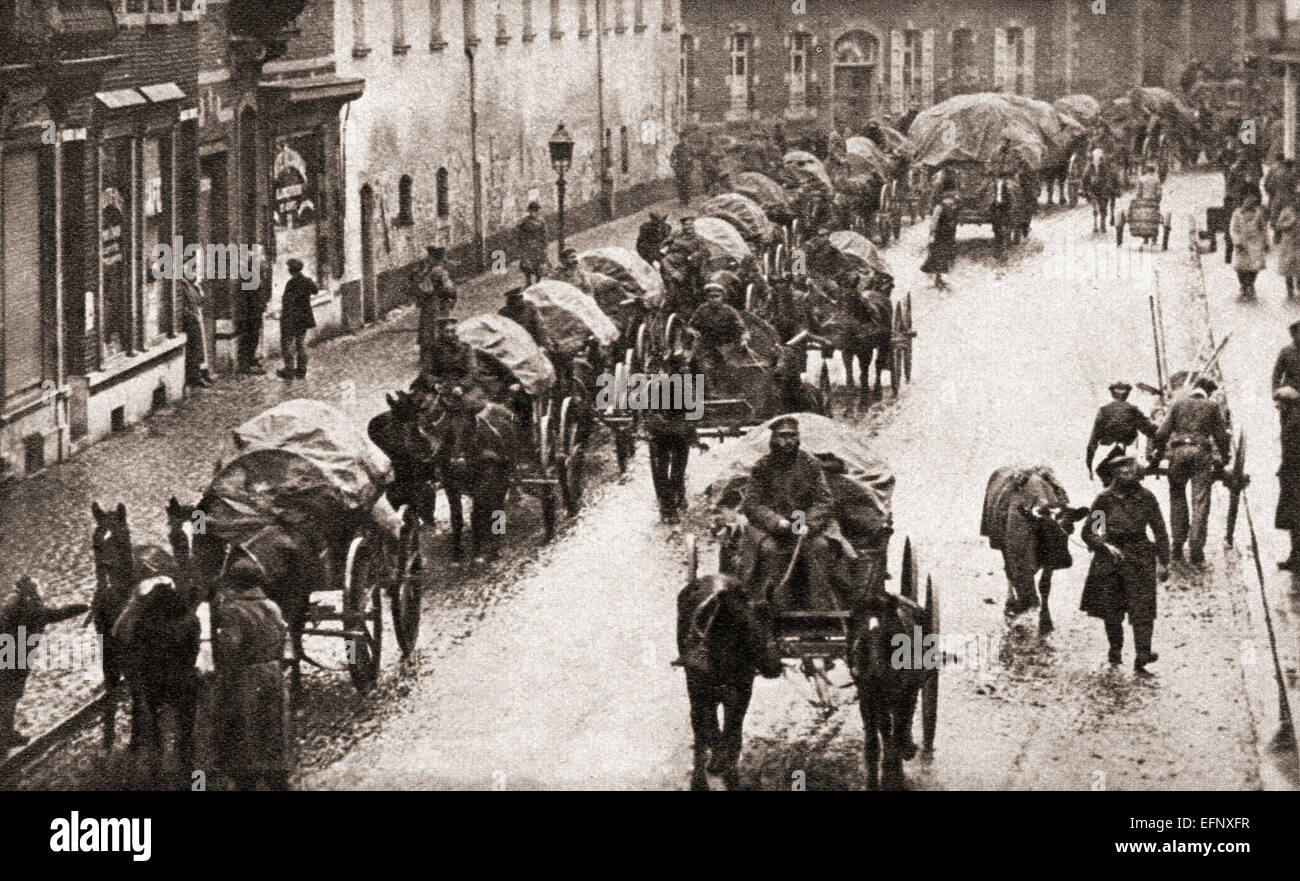A line of waggons and broken German troops march through Belgium in their retreat at the end of World War One. - Stock Image