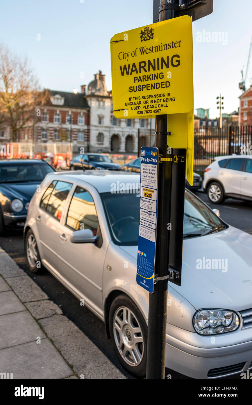 A car parked in a bay marked Parking Suspended in the City of Westminster, London, UK - Stock Image