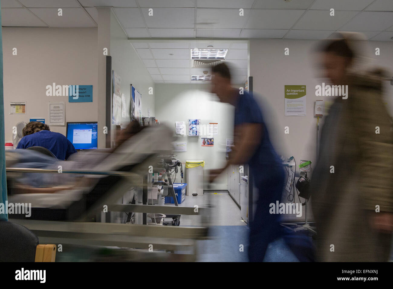 A busy hospital with doctors, nurses and staff busy at work in an accident and emergency ward in a British hospital - Stock Image