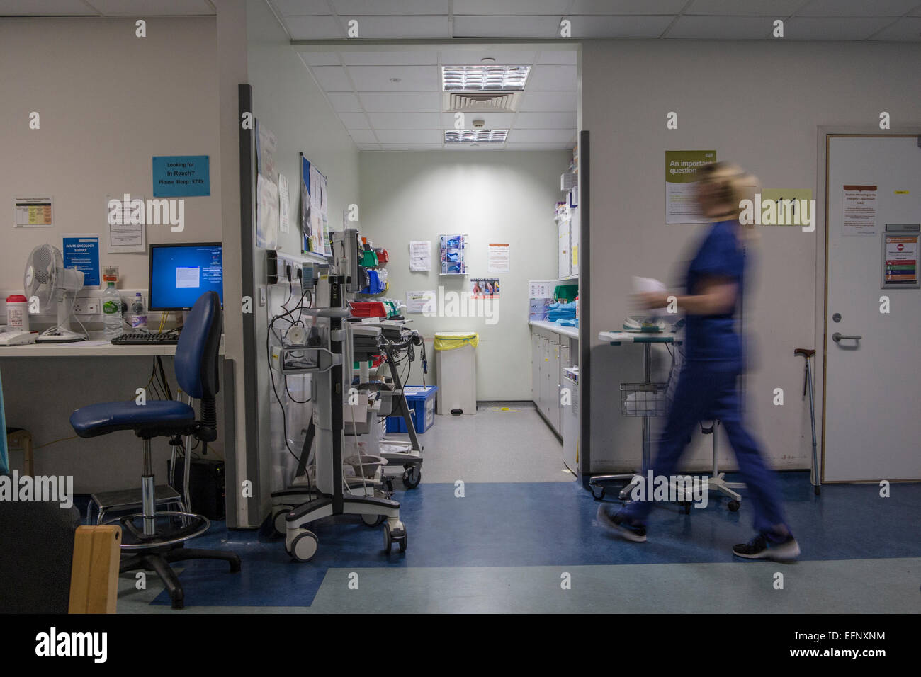 A busy hospital with doctors, nurses and staff busy at work in an accident and emergency ward in a British hospital Stock Photo
