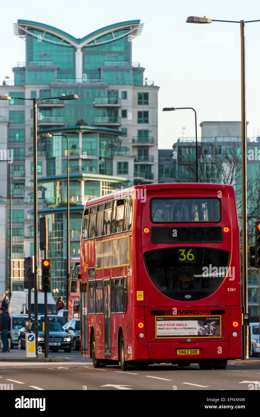 A London red bus drives up Vauxhall Bridge Road, - Stock Image