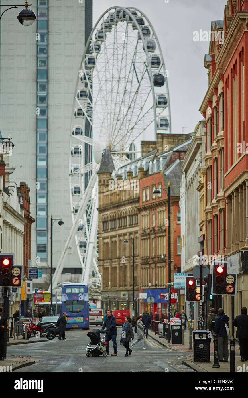 Northern Quarter Manchester Uk.looking down Oldham Street into the centre and the big Wheel - Stock Image