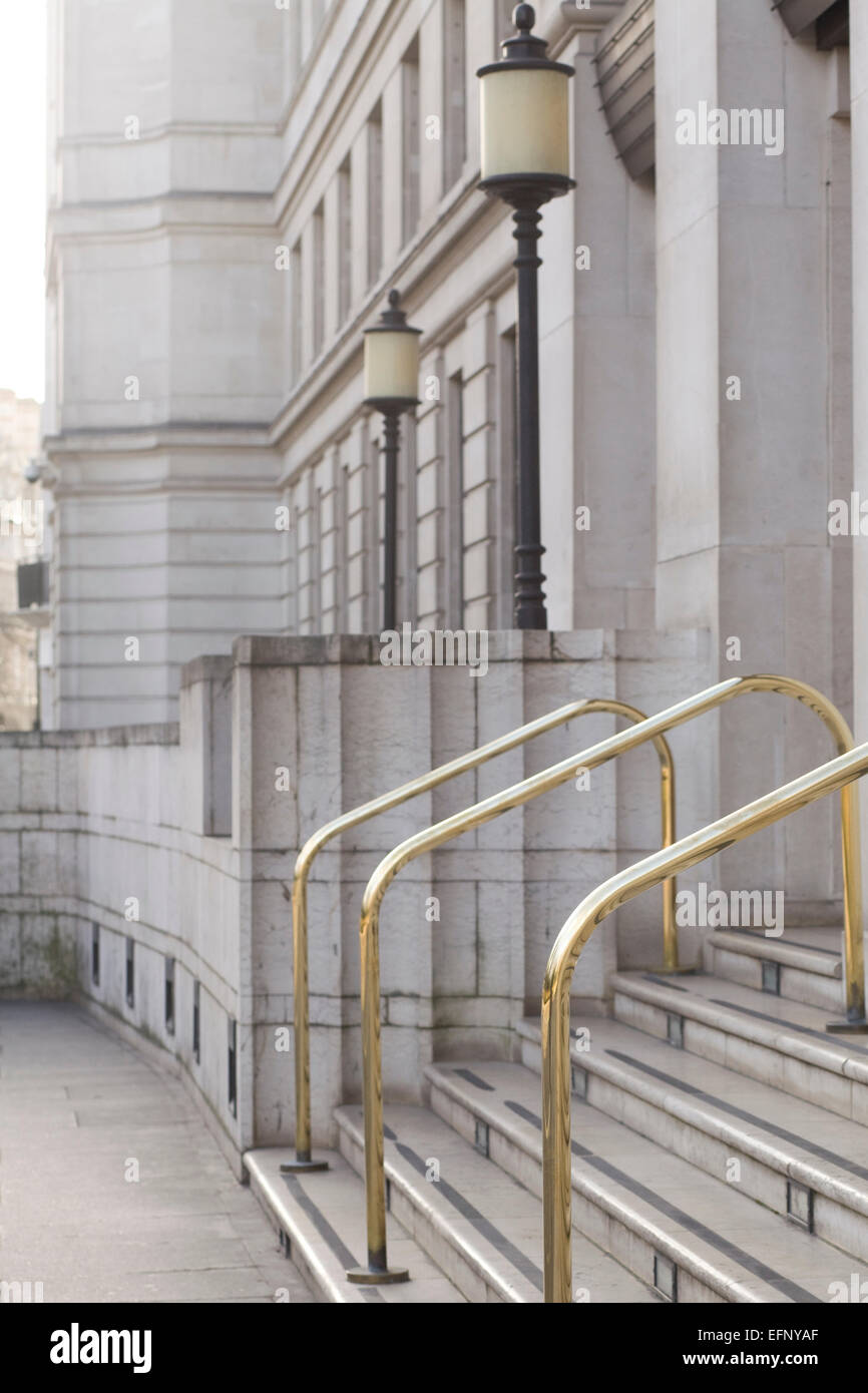 Gold Hand Rails for steps on a office building in London - Stock Image