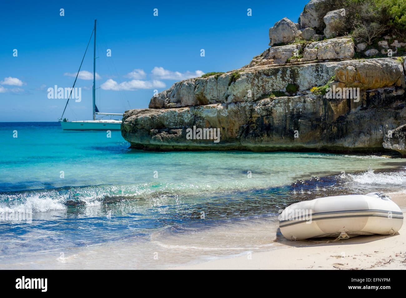 Dinghy at sand beach - Stock Image