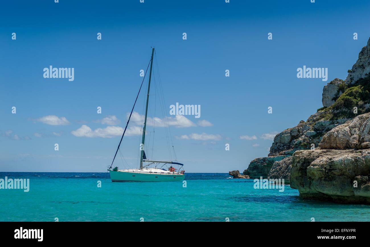Sailing yacht at the horizon - Stock Image