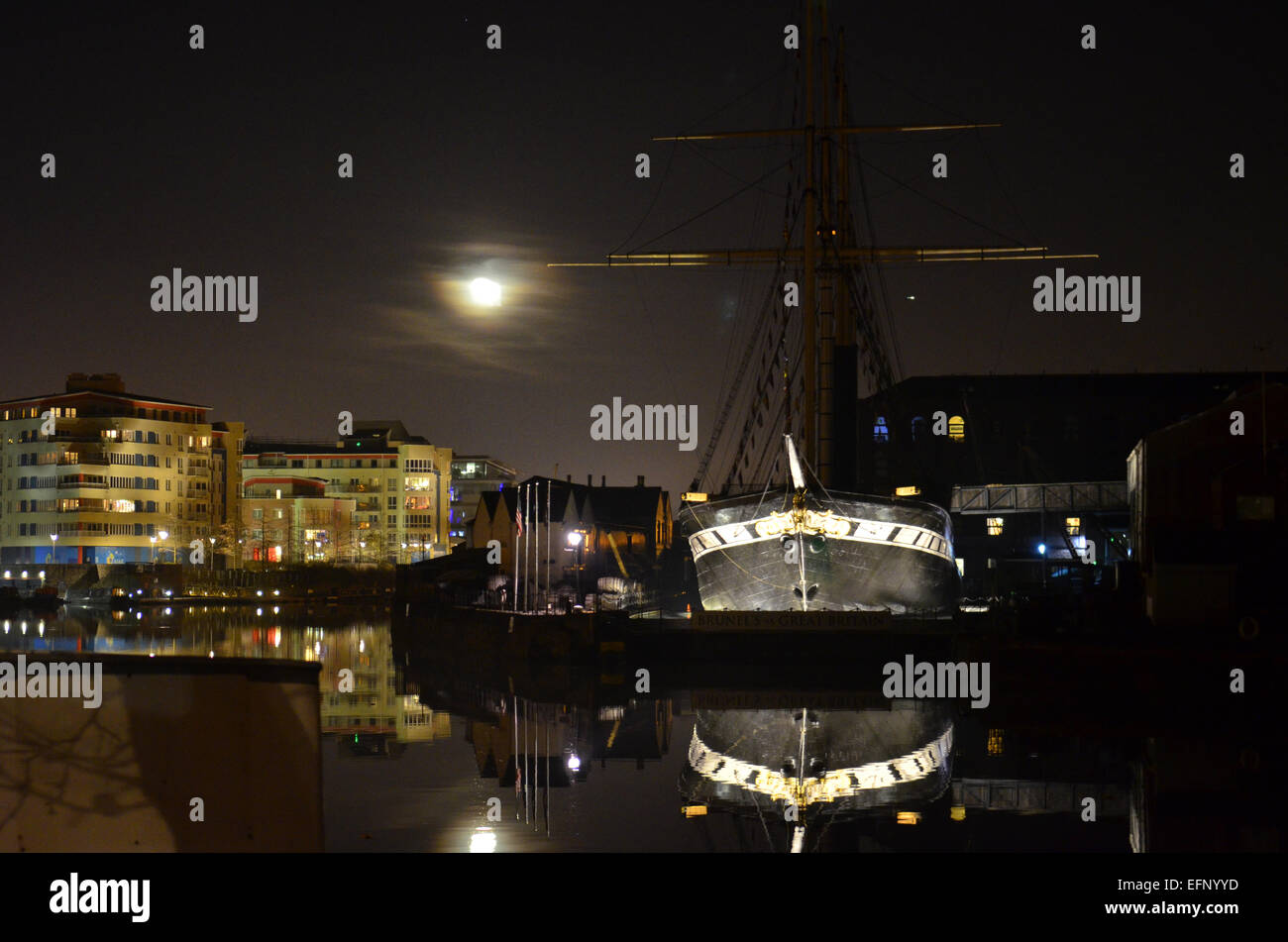 Bristol, UK. 8th February, 2015. World famous SS Great Britain floating Museum seen with moon on a calm evening - Stock Image