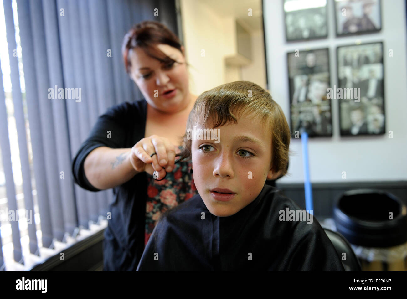 9 Year Old Boy Having A Haircut In Barbers Shop In Great Ayton