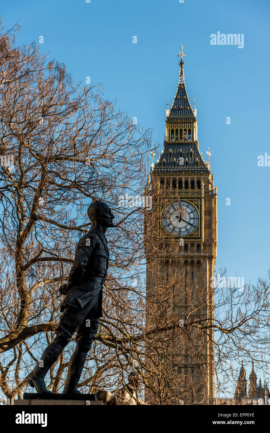 A statue of Jan Smuts Prime Minister of South Africa on Parliament Square leans towards Big Ben clock-tower, London - Stock Image