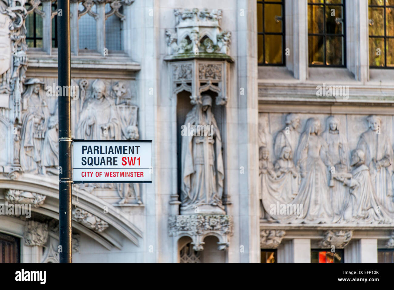 A sign reads Parliament Square SW1 City of Westminster; the square is famous for the Houses of Parliament, London - Stock Image