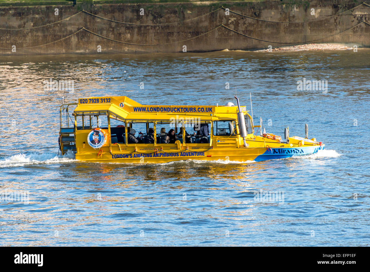London Duck Tours is a sighseeing tour on board a vehicle which can drive on the road and enter the River Thames - Stock Image