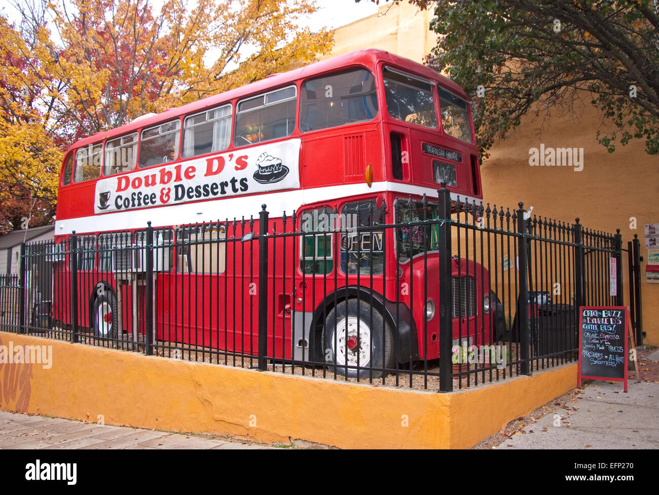 Double D's coffee shop in converted old London double decker bus in downtown Asheville, North Carolina. - Stock Image