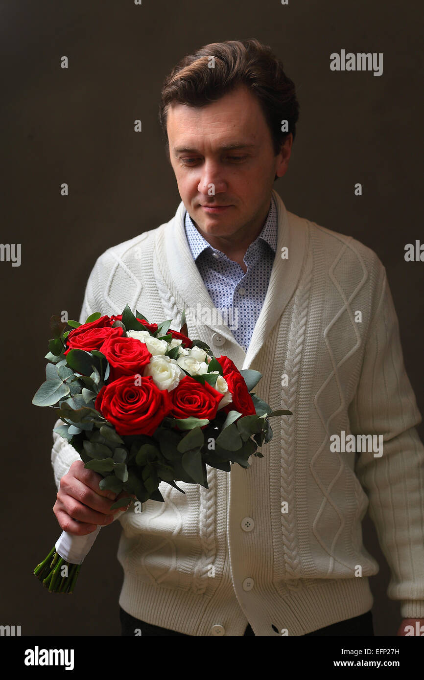 lover with a bouquet of roses - Stock Image