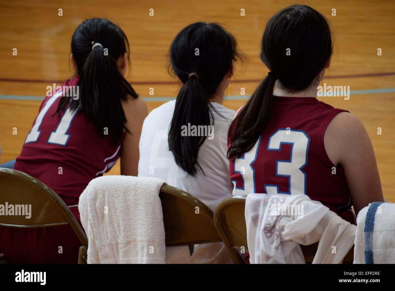 3 female basketball players with ponytails - Stock Image