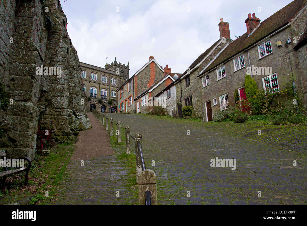 View from the bottom of Gold Hill, famous cobbled street in Shaftesbury, Dorset, England, looking uphill in December - Stock Image