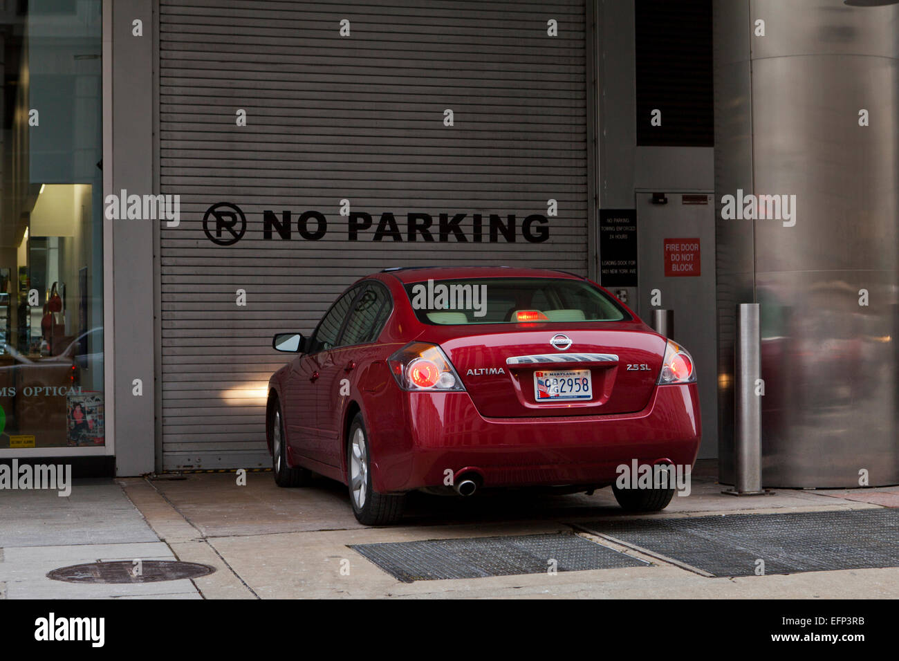 Car parked under no parking sign - USA - Stock Image