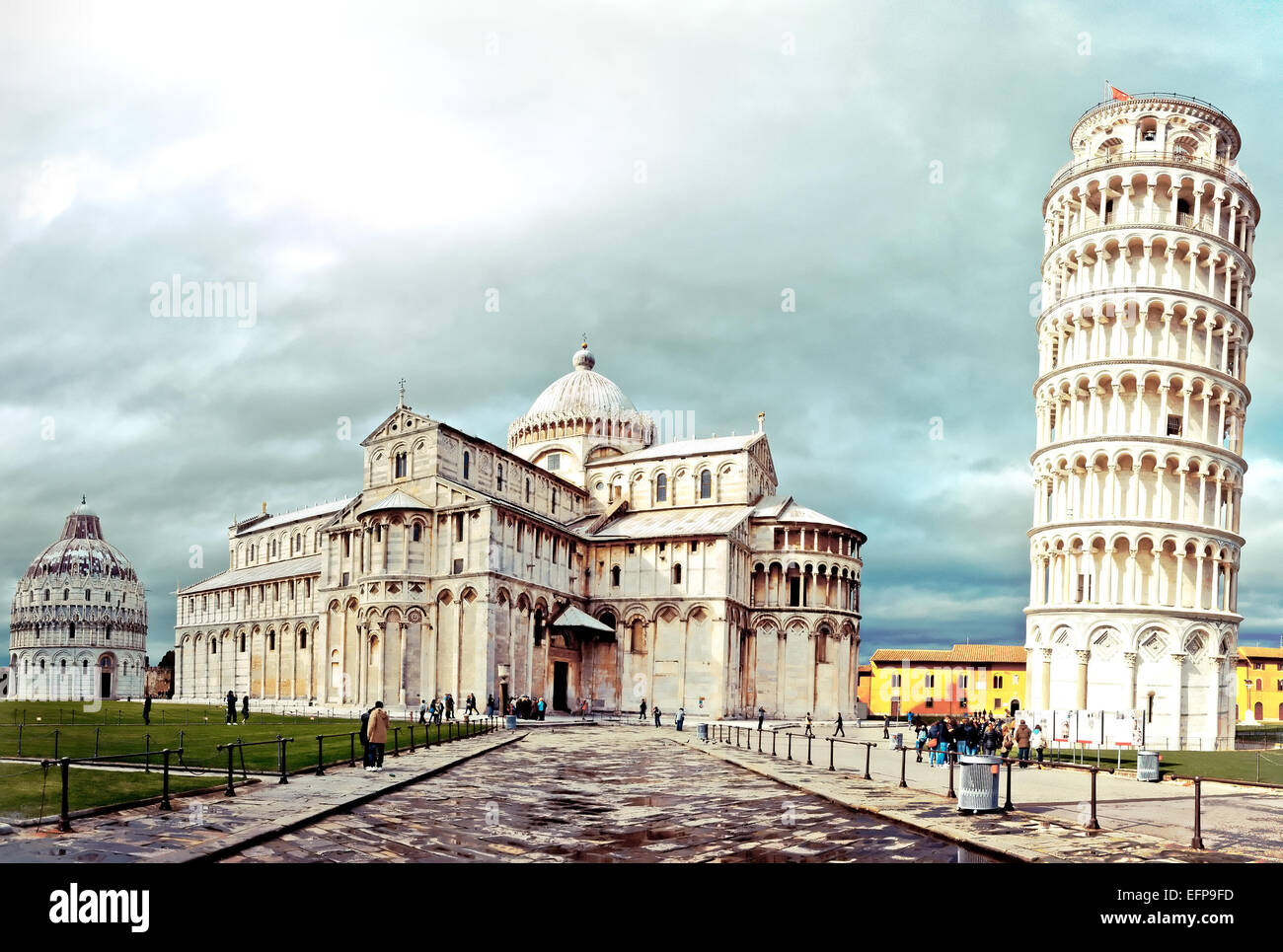 Pisa, Italy - March 18, 2013: tourists visiting the world famous leaning tower in Pisa, Italy. Up to 4, 5 million - Stock Image