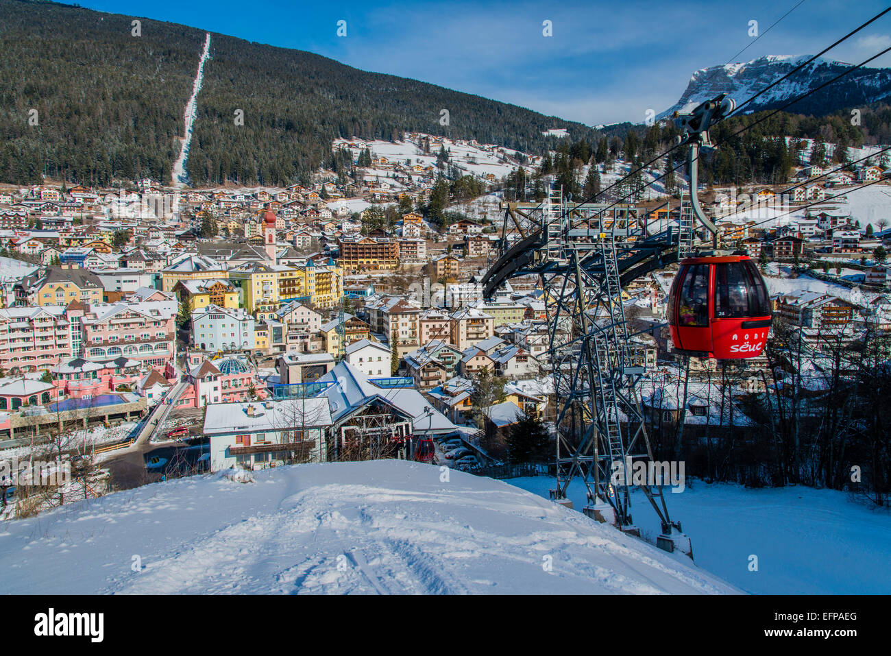 Winter top view of Ortisei St Ulrich with Seiser Alm gondola lift, Dolomites, Alto Adige, South Tyrol, Italy - Stock Image