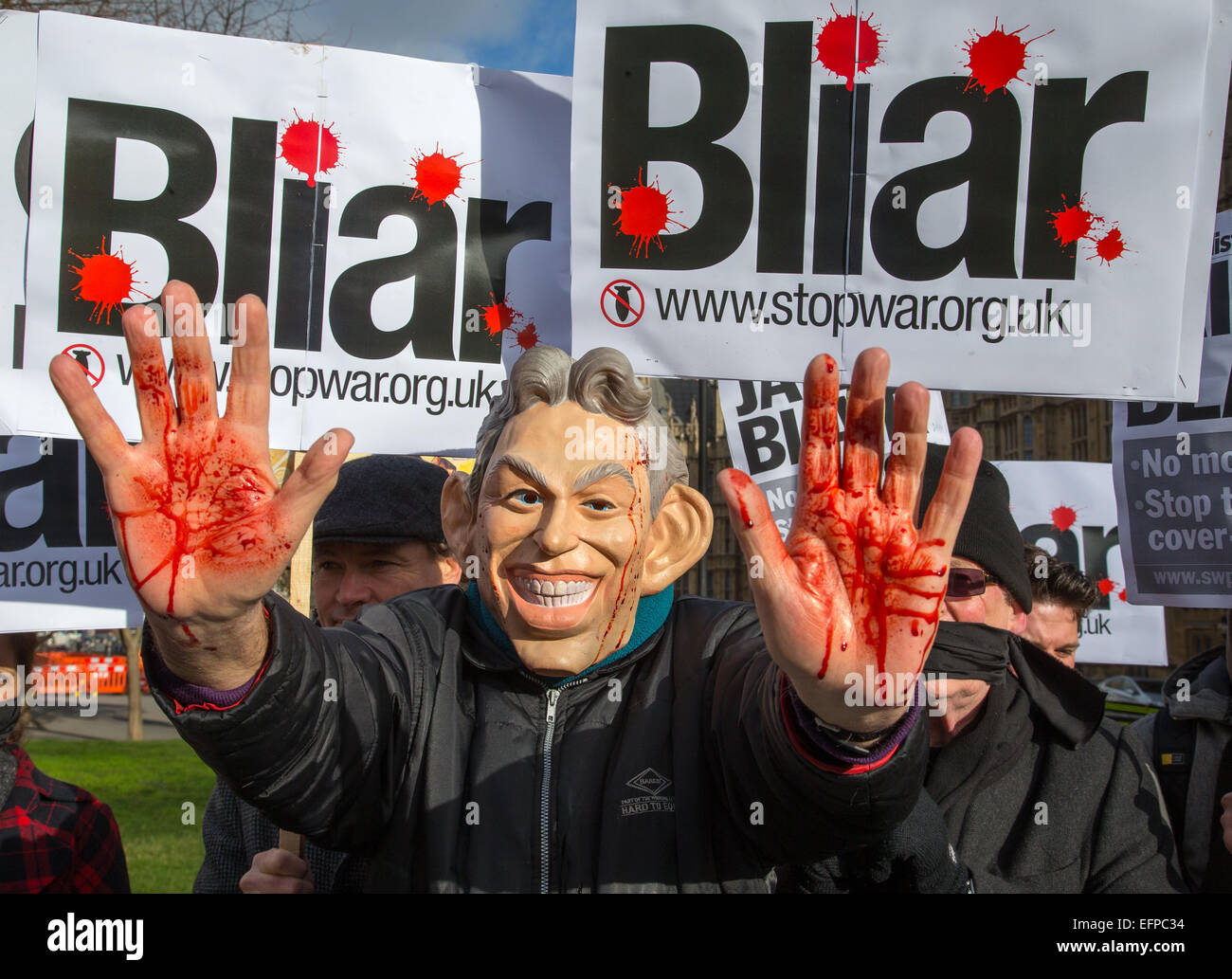 Tony Blair mask with blood on his hands at demonstration outside Parliament over the invasion of Iraq in 2003 - Stock Image