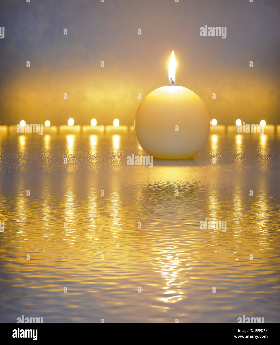 Japanese ZEN garden with candle lights mirroring in water - Stock Image