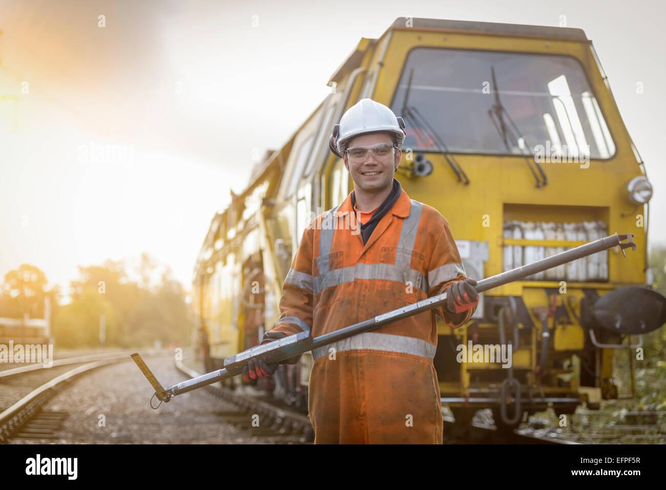 Portrait of maintenance apprentice on railway - Stock Image
