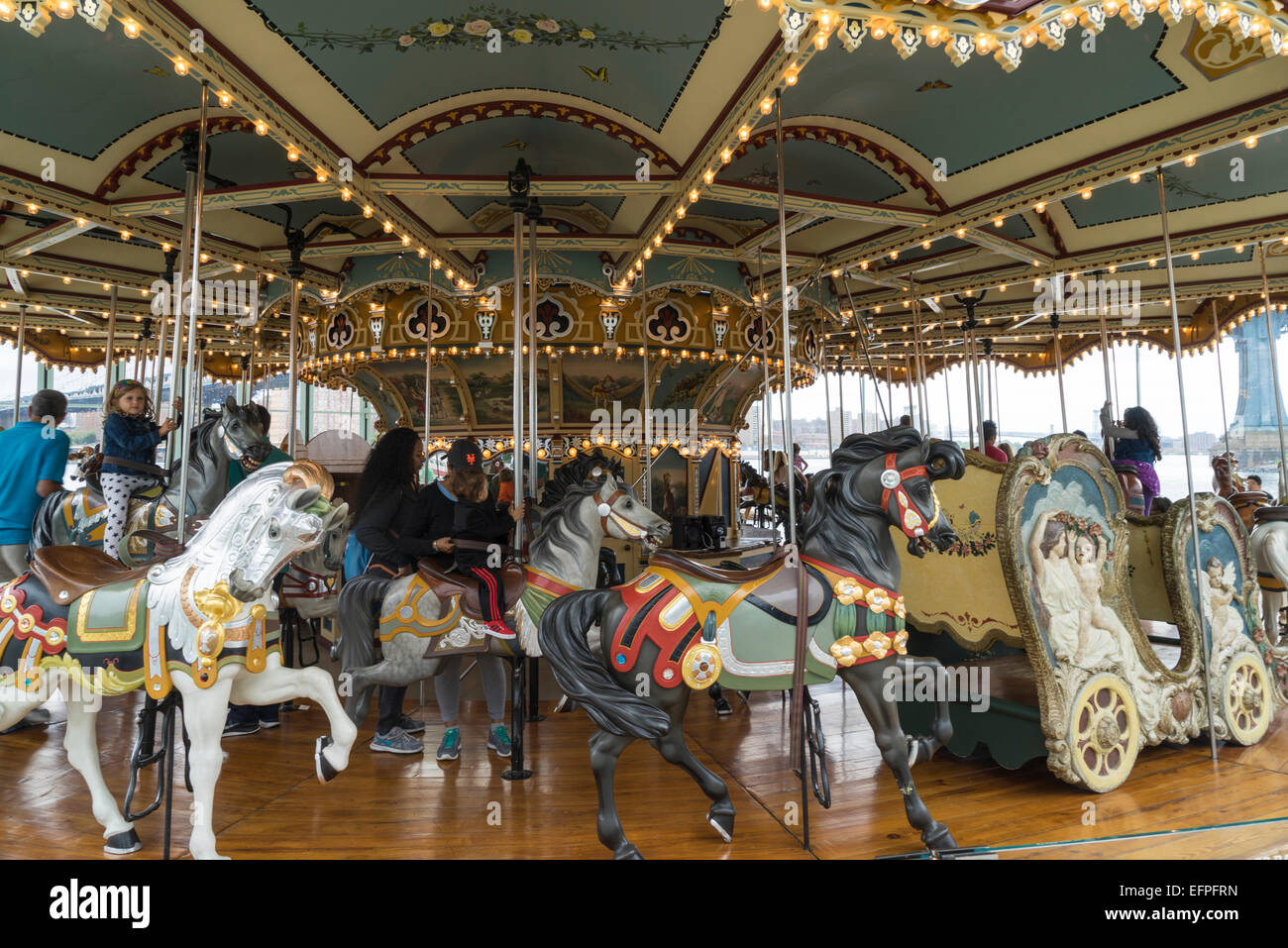 Jane's Carousel, a restored 1920s fairground carousel now located in Brooklyn Bridge Park, Brooklyn, New York, - Stock Image