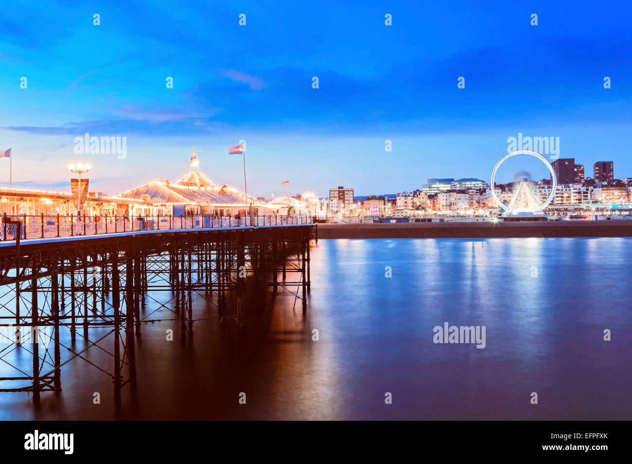 The Palace Pier (Brighton Pier) at dusk, Brighton, East Sussex, England, United Kingdom, Europe - Stock Image