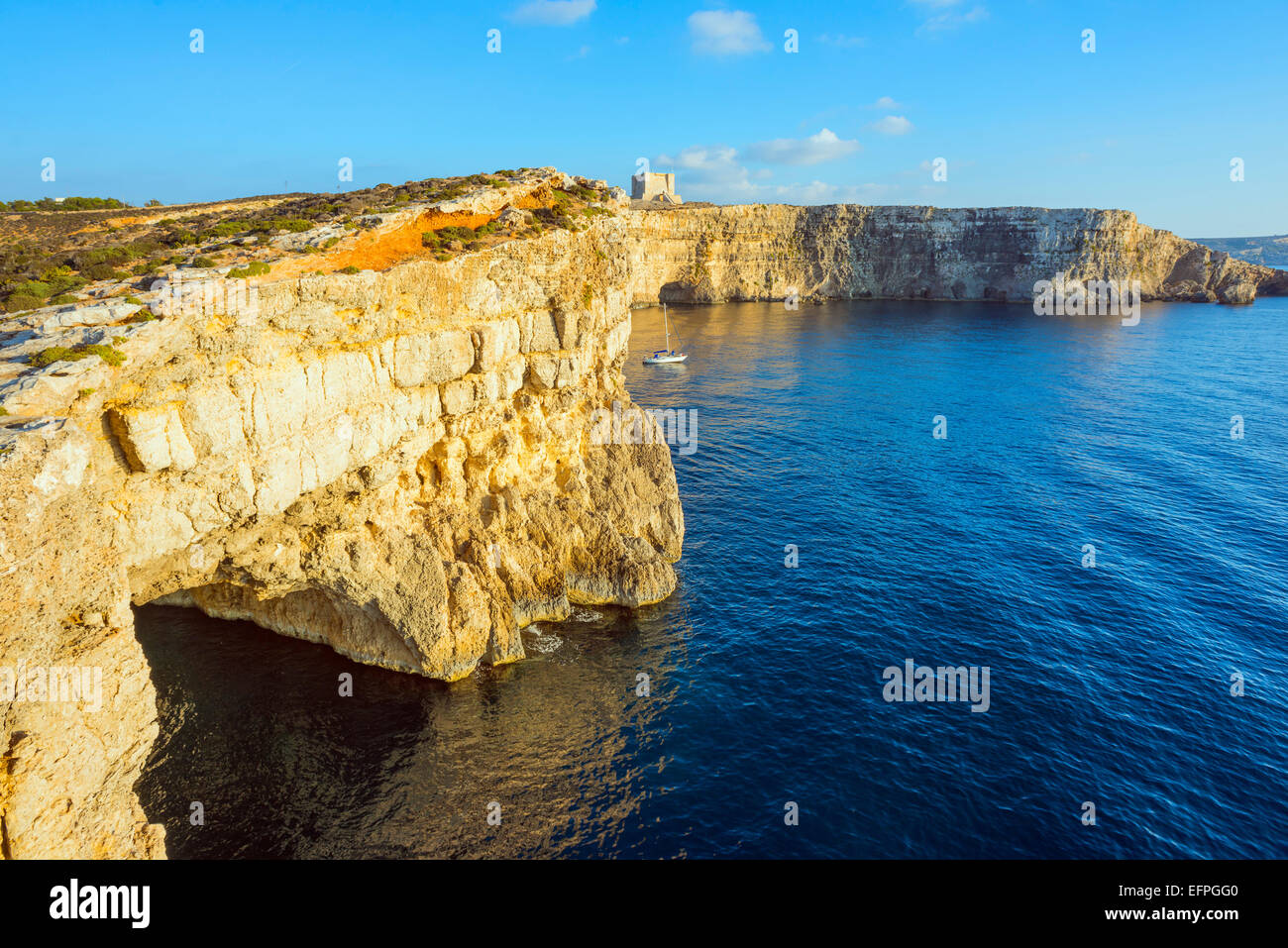 Cliff top watch tower, Comino island, Malta, Mediterranean, Europe - Stock Image