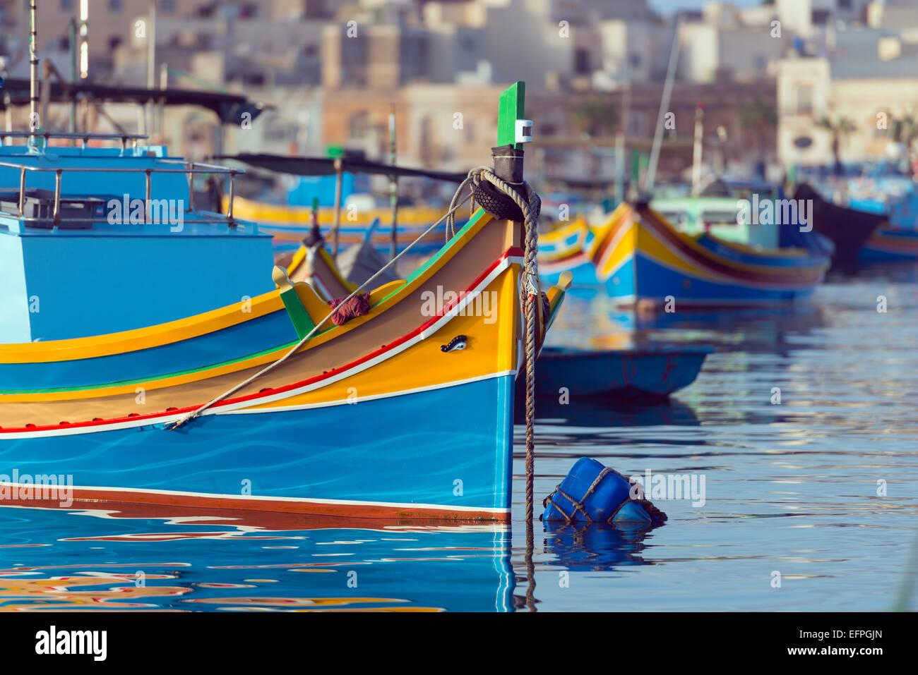 Colourful fishing boats (dghajsa), Marsaxlokk Harbour, Malta, Mediterranean, Europe Stock Photo