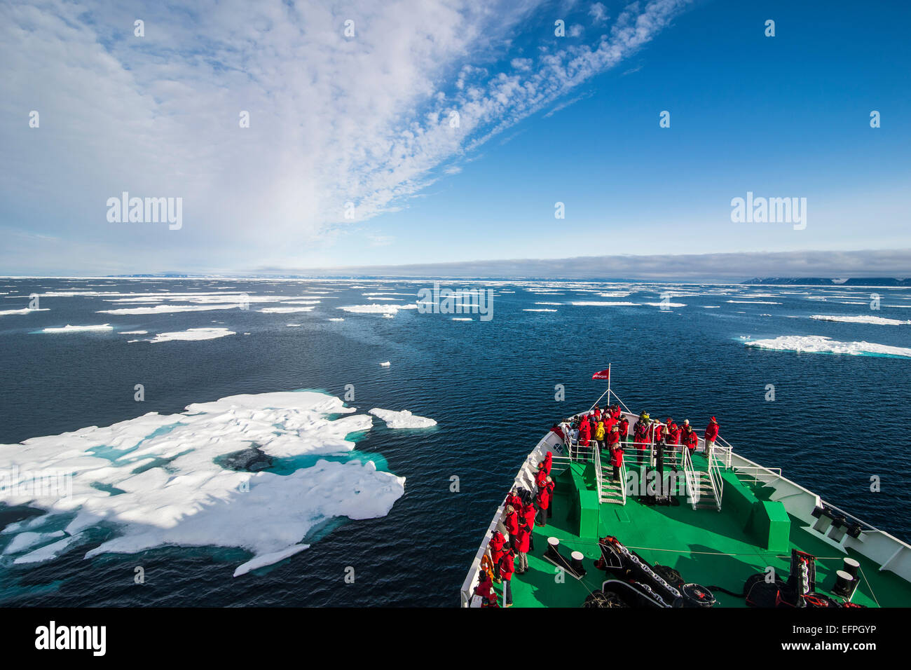 Expedition boat entering the pack ice in the Arctic shelf, Svalbard, Arctic - Stock Image