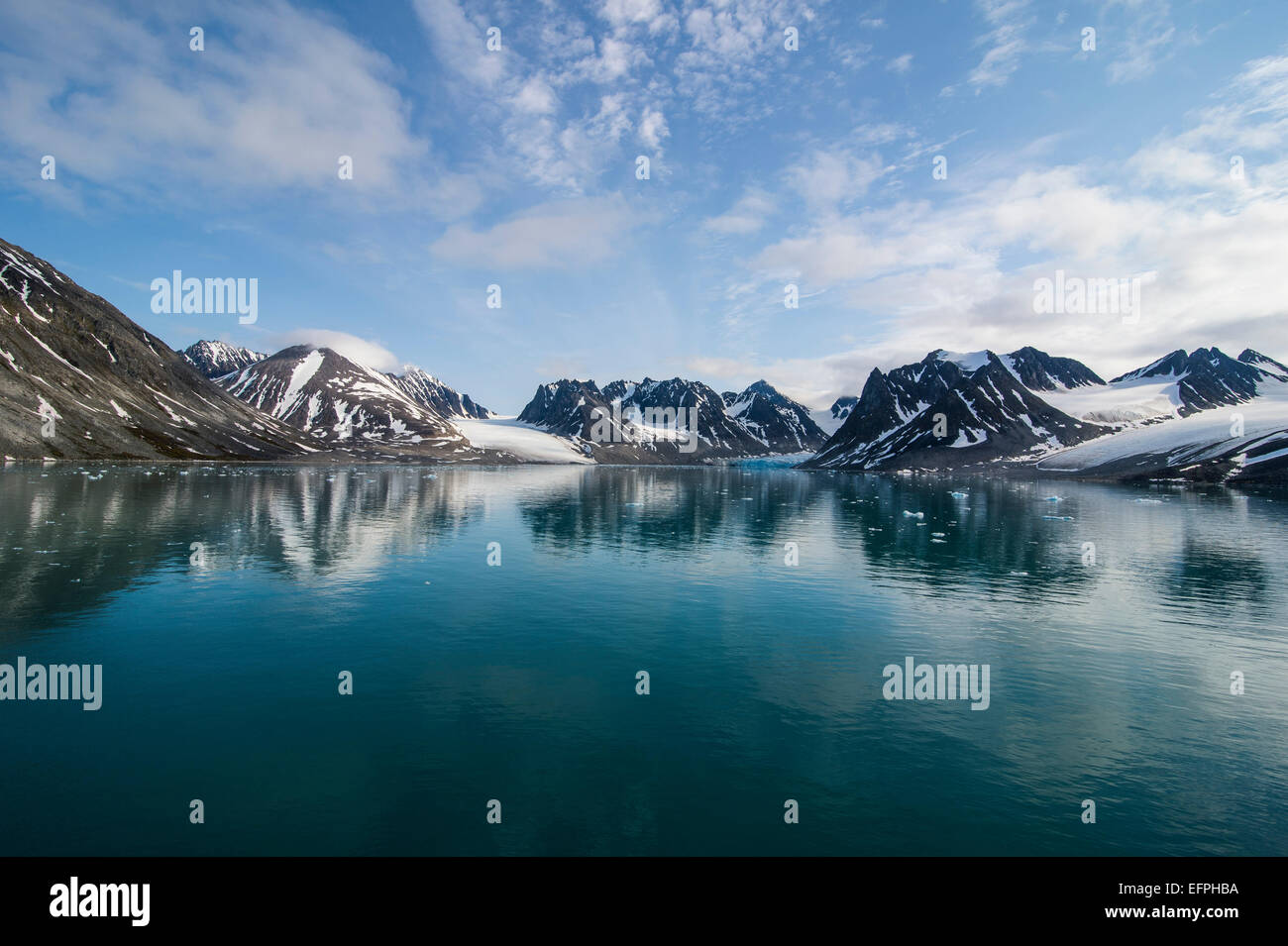 Mountains reflecting in the water in the Magdalenen Fjord, Svalbard, Arctic, Norway, Scandinavia, Europe - Stock Image