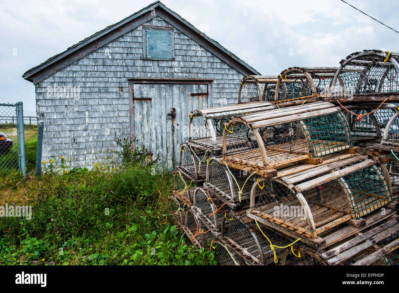 Fish traps in front of a shingle hut in Neils Harbour, Cape Breton Highlands NP, Cape Breton Island, Nova Scotia, - Stock Image